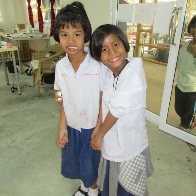 2 smiling kids after dental treatment